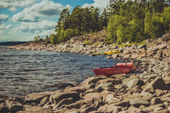 Two kayaks on the lake. Extreme tourism on the lake. Kayaks landing on the coast Royalty Free Stock Image
