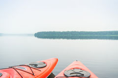Two kayaks on the middle of beautiful calm lake Royalty Free Stock Photography