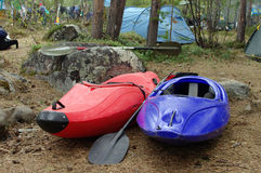 Two kayaks near forest camp Royalty Free Stock Photo