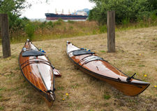 Two kayaks and one ship Royalty Free Stock Photography