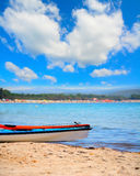 Two kayaks on the sand under a cloudy sky in Alghero Stock Images