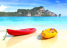 Two kayaks on a tropical beach, shallow depth of field. Royalty Free Stock Image