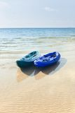 Two kayaks on a tropical beach in Thailand Royalty Free Stock Images