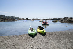 Two kayaks at waters edge. Stock Photography