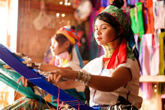 Two Kayan Lahwi girl is weaving. Stock Image