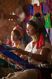 Two Kayan Lahwi girl is weaving. Stock Images