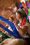 Two Kayan Lahwi girl is weaving. Stock Photos