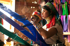 Two Kayan Lahwi girl is weaving. Royalty Free Stock Photos