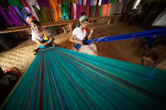 Two Kayan Lahwi girl is weaving. Royalty Free Stock Photos