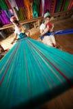Two Kayan Lahwi girl is weaving. Royalty Free Stock Image