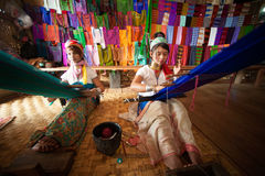 Two Kayan Lahwi girl is weaving. Royalty Free Stock Photo