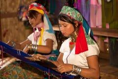 Two Kayan Lahwi girl is weaving. Stock Image