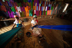 Two Kayan Lahwi girl is weaving. Royalty Free Stock Photography