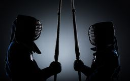 Two kendo fighters opposite each other. With shinai. Japanese martial art of sword fighting Royalty Free Stock Images