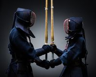Two kendo fighters with shinai opposite each other. Japanese martial art of sword fighting Stock Photos