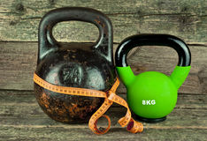 Two kettlebells on a wooden background Royalty Free Stock Image