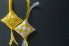 Ketupat. The Colorful ribbons of ketupat with dark background