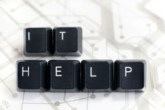 IT, Two Keyboard keys with letters I and T on Circuit Board. IT HELP - Helpdesk - Black Keyboard keys IT HELP on White Circuit Board Background Stock Image