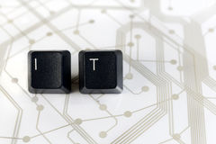 IT, Two Keyboard keys with letters I and T on Circuit Board Stock Image
