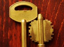 Two keys on a dark wooden background. Real estate concept. Two keys on a dark wooden background Stock Images