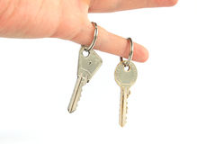 Two keys on finger Stock Photography
