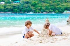 Two kid boys building sand castle on tropical beach Stock Photography