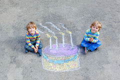 Two kid boys having fun with colorful birthday Stock Images