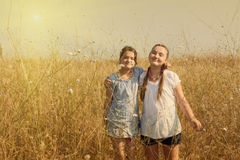 Two kid girls having fun on the field Royalty Free Stock Photography