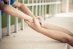 Two kid hand hold together Stock Image