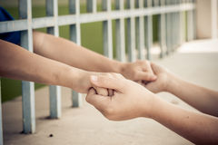 Two kid hand hold together Royalty Free Stock Photos