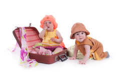 Two kids. Portrait of two kids with a large suitcase Royalty Free Stock Photo