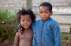 Two kids. A sad boy and a girl in the townships royalty free stock photography