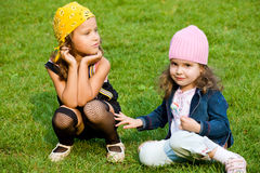 Two kids. Portrait of two kids on green grass Royalty Free Stock Image