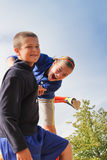 Two kids against blue sky Royalty Free Stock Image