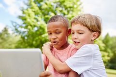 Two kids as friends with laptop Stock Photos