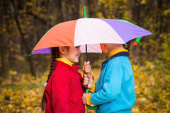 Two kids in autumn forest Stock Images