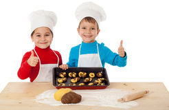 Two kids with baking and ok sign Royalty Free Stock Images