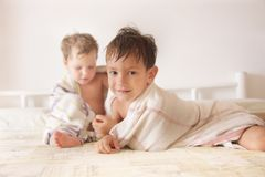Two kids after bath Royalty Free Stock Photos