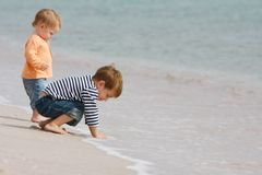 Two kids on beach Stock Photography