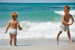 Two kids on beach Stock Images