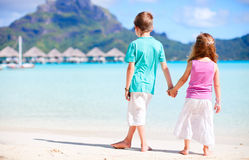 Two kids at beach Stock Images