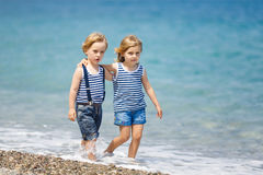 Two kids on the beach Royalty Free Stock Photo
