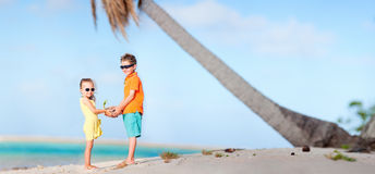 Two kids at beach panorama stock photography