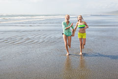 Two kids at the beach Stock Photography