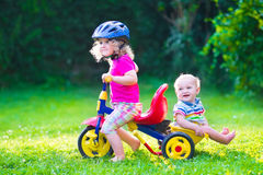 Two kids on a bike Royalty Free Stock Photos