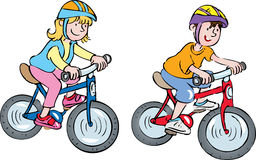 Two kids on bikes. Two cartoon children wearing crash helmets riding their bikes Stock Photography