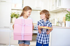 Two kids at birthday with gift and cake Royalty Free Stock Photos