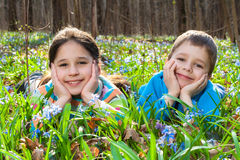 Two Kids among the bluebells Stock Image