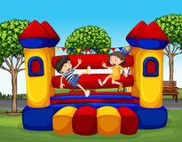 Two kids bouncing on the rubber house Royalty Free Stock Photography