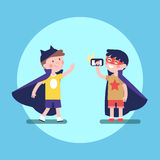 Two kids boys taking photos in superhero costumes. Two kids boys friends taking photos of each other in superhero costumes. Modern flat vector illustration Stock Images